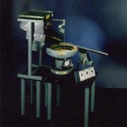 Automatic Aligning and Orientating Part-West North Machine Works, Ltd.